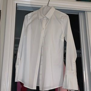 Crisp white work shirt with pleated sleeves!